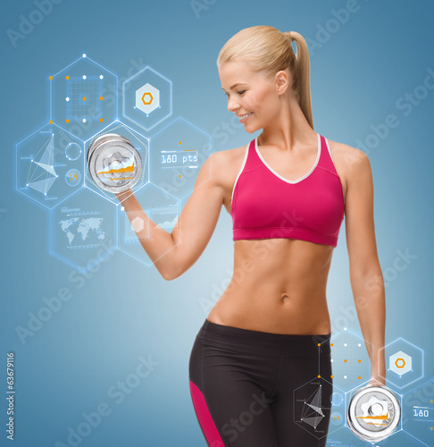 smiling woman lifting steel dumbbell