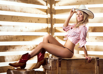 Young, happy and beautiful cowgirl in sexy underwear