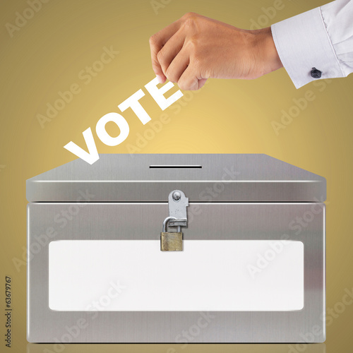 Hand with ballot and metal box