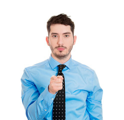 Serious young man pointing finger at you, white background