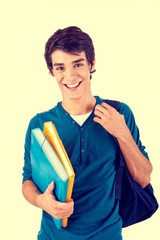 Young happy student carrying books