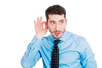 Gossip, rumors. Nosy man listening to someone's conversation
