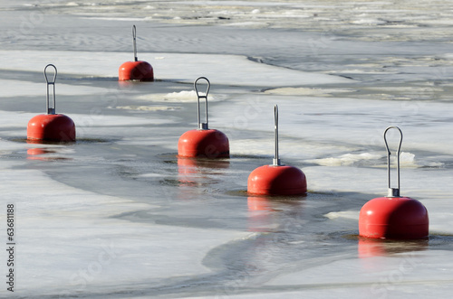 red buoys in the frozen water