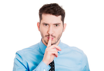Shhhh. Young business man, boss asking to be quiet