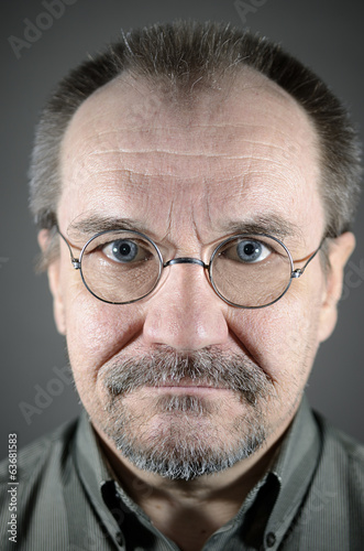 middle-aged man with glasses, mustache and beard