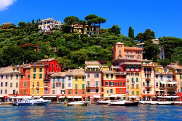 Colorful houses of the harbor at Portofino, Italy with boats