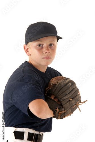 young caucasian baseball player with hand in glove