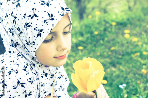Little muslim girl outdoor - Spring time
