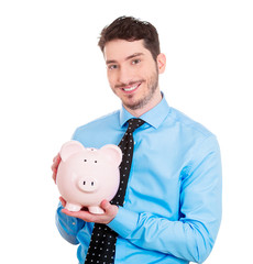 Happy business man holding piggy bank, savings