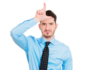 Young business man, student giving a loser sign
