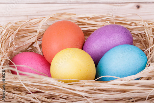 Colored eggs in a nest