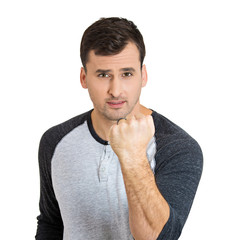 Man ready to fight, fist up in air, isolated on white background