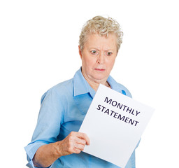 Angry older woman unhappy with her monthly statement