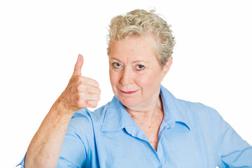 Senior, old woman giving thumbs up