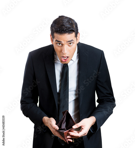 Sad, surprised business man holding empty wallet