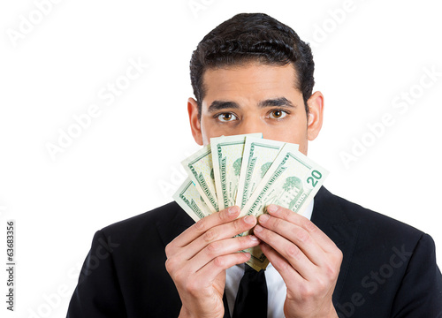Money, greed, politics. Man holding cash