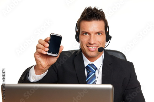 Handsome customer service operator shows mobile phone