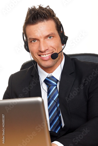 Handsome customer service operator speaks with a some customer
