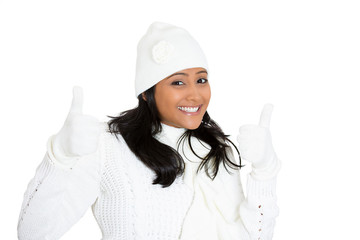 Winter woman showing approval giving thumbs up