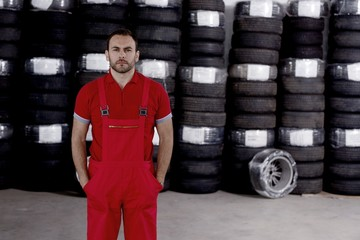 mechanic with car tires