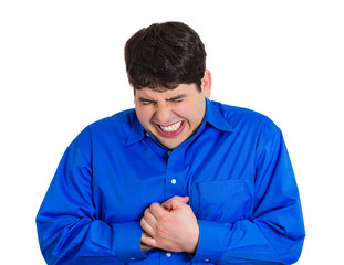 Young man having sudden chest pain