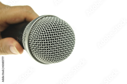 Hand hold black and silver microphone isolated