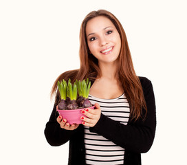 beautiful young woman with flowers in pot, white background