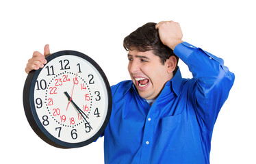 Running out of time, stressed business man holding wall clock
