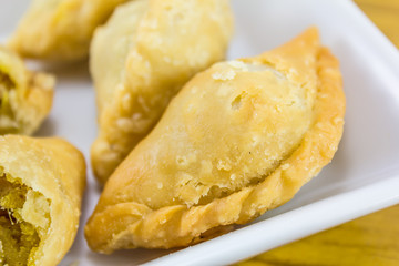 curry puffs on white plate