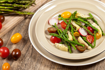 Vegetable salad with asparagus and tomato
