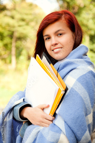 student girl in the park in chilly day, smiling