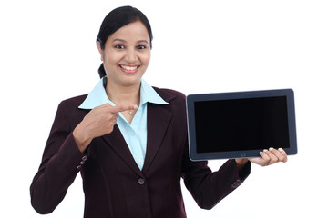Young business woman showing tablet computer
