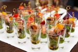 Various snacks in shot glasses - 63685367