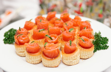 Tartlets with salmon on table