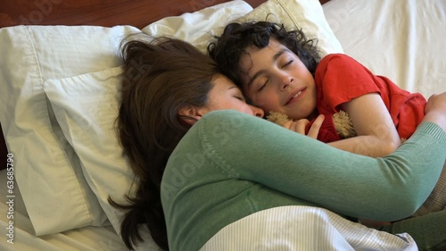 Single mother and son sleeping together