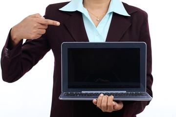 Happy young business woman showing tablet computer