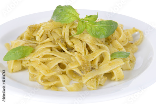Delicious pasta with pesto on plate close-up
