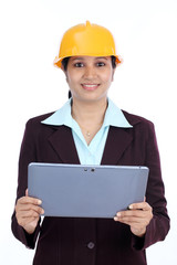 Young Indian female engineer with tablet computer