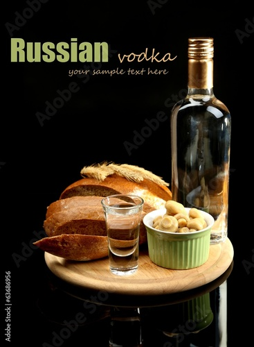 Composition with bottle of vodka, glass, and marinated