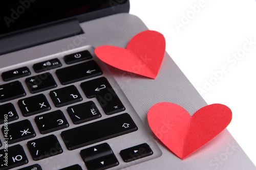 Red hearts on computer keyboard close up