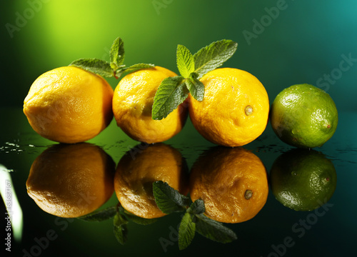 Lemons and lime on dark background