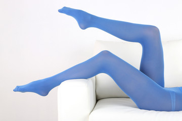 Stockings on perfect woman legs, close up