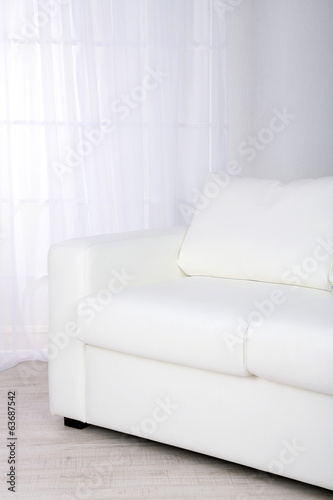 White leather sofa in room