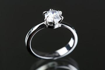Beautiful diamond ring on gray background