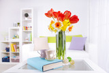 Fototapety Beautiful spring flowers in vase on home interior background