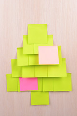 Christmas tree made of adhesive note close-up