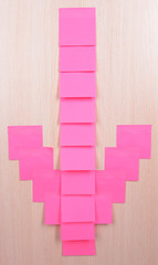 Arrow made of adhesive note close-up