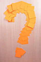 Question mark made of adhesive note close-up