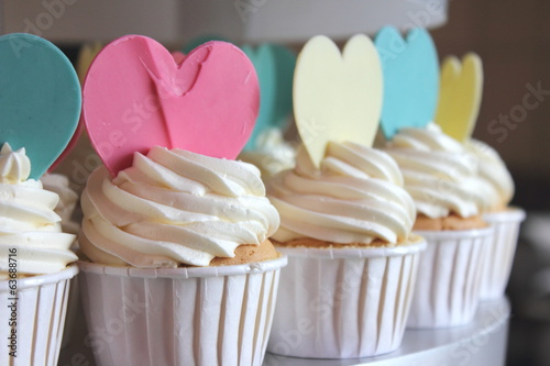 Cupcake decorated with frosting and sugar hearts.