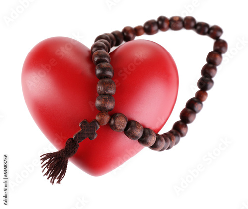 Heart with rosary beads isolated on white